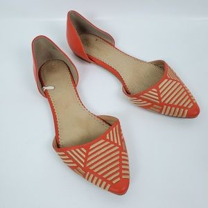 Restricted orange and gold flats